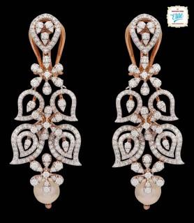 Pear Tilt Diamond Earrings...